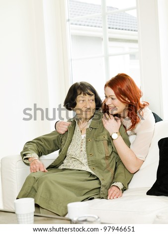Young woman happy with her Grandmother - stock photo