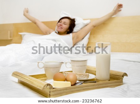 Young woman has a breakfast in the bed