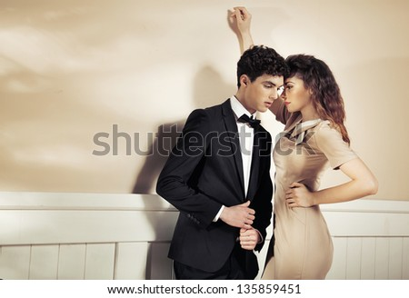 Young woman has an affair with sexy man - stock photo
