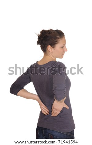 young woman has back pain - stock photo