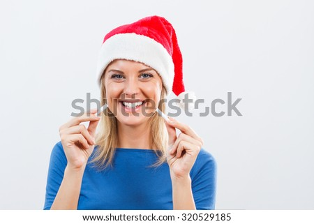 Young woman has decided  to start a new life without cigarettes in the new year.New Year's stop smoking resolution - stock photo