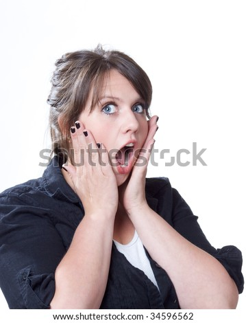 Young woman has hands to face in shock and amazement; isolated on a white background. - stock photo