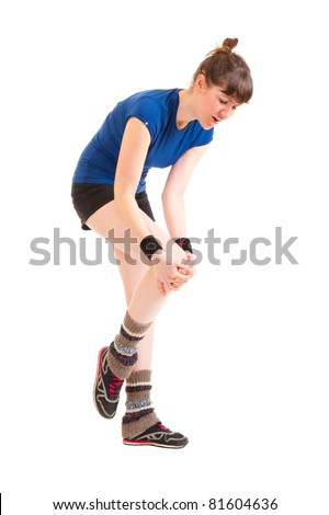 Young woman has hit a knee and it hurts - stock photo