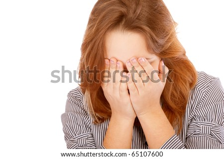 Young woman has shut face with hands, isolated on white background.