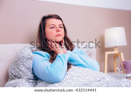 Young woman has strong sore throat