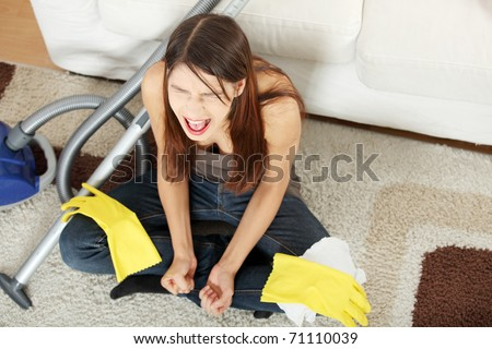 Young woman hates cleaning home. - stock photo