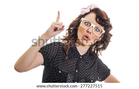 Young woman have a idea and showing with her finger up. Surprised girl gesturing, isolated on white - stock photo