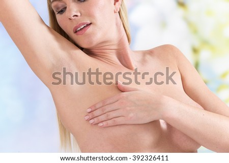 Young woman have applied stick of deodorant - stock photo