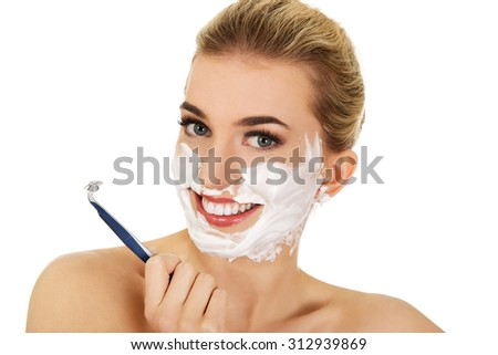 Young woman have morning shave,isolated on white. - stock photo