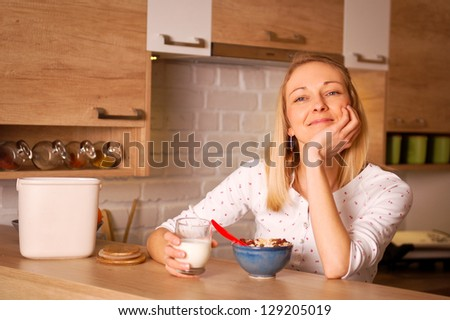 Young woman having a bowl of cereal