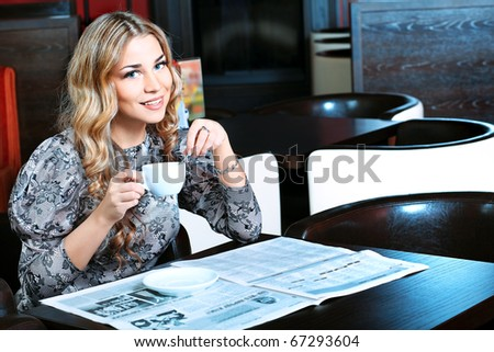 Young woman having a break at a caf - stock photo