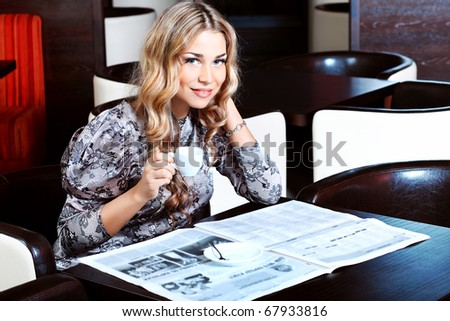 Young woman having a break at a cafe. - stock photo