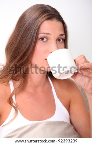 Young woman having a coffee - stock photo