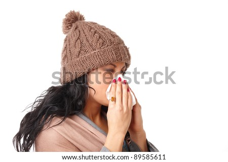 Young woman having a cold and sneezing isolated on white background - stock photo