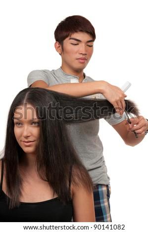 Young woman having a haircut - stock photo