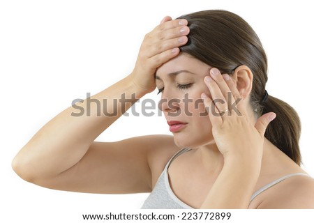 Young woman having a headache isolated on white