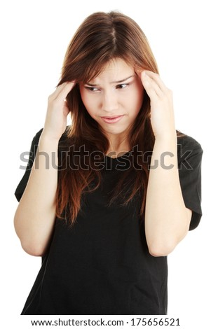 Young woman having a headache ,isolated on white background - stock photo