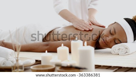 Young Woman Having A Massage In Spa - stock photo