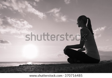 Young woman having a peaceful moment.  - stock photo