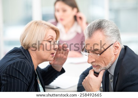 Young woman having an interview or business meeting with employers. Employers deciding to hire woman. Office interior with big window - stock photo