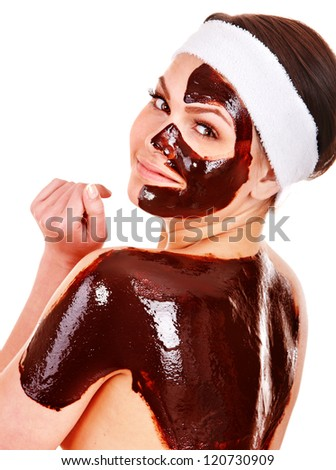 Young woman having chocolate facial mask. Isolated. - stock photo