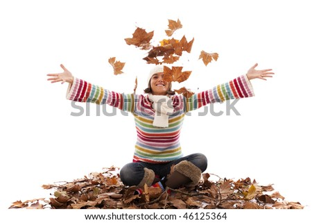 young woman having fun at the autumn season (motion blur on the leaves) - stock photo