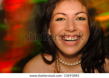 Young woman having fun in a party