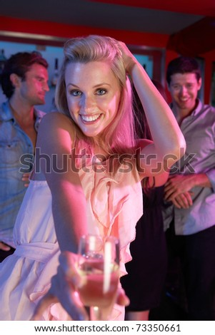 Young Woman Having Fun In Busy Bar - stock photo