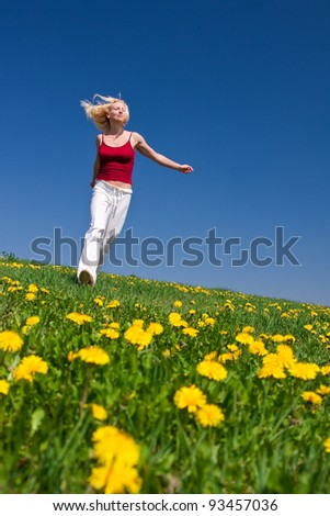 young woman having fun on a flowery meadow - stock photo
