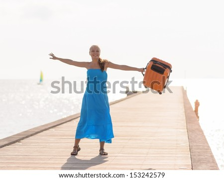 Young woman having fun on wooden pier. - stock photo