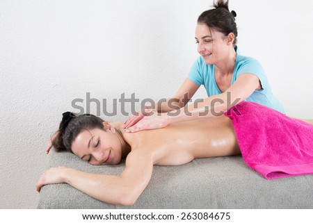 Young woman having massage - stock photo