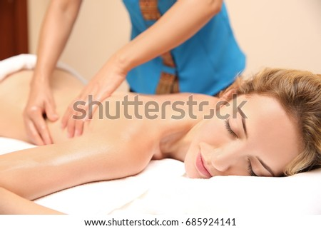 Young woman having massage in spa salon, closeup view