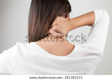 Young woman having pain in the back and neck,Pain in the back - stock photo
