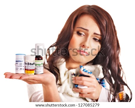 Young woman having pills and tablets. Sharpness is on medication. - stock photo