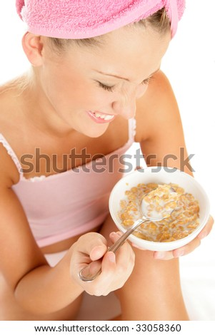 Young woman heaving breakfast isolated on white background - stock photo