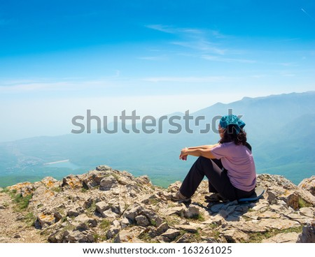 Young woman hiker enjoys the view