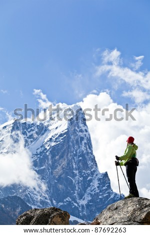 Young woman hiker hiking in Himalaya Mountains in Nepal - stock photo