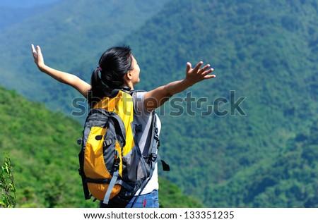 young woman hiker mountain peak - stock photo
