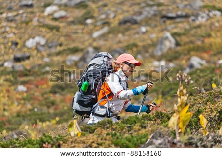 Young woman hiker trekking in Himalaya Mountains in Nepal - stock photo