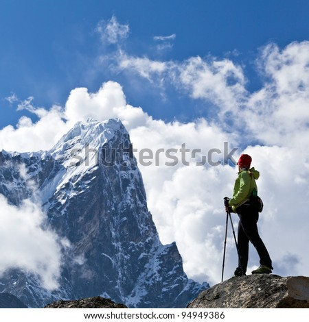 Young woman hiker trekking in Himalaya Mountains in Nepal - stock photo