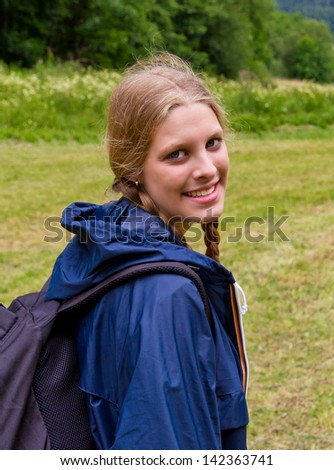 Young woman hiking - stock photo