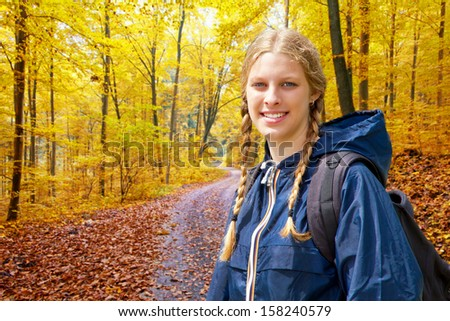 Young woman hiking in autumn - stock photo
