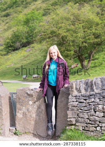 young woman hiking in Dovedale in the Peak District National Park - stock photo