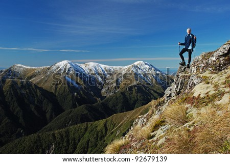young woman hiking in mountains - stock photo