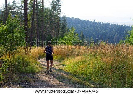 Young woman hiking in the hills of Slovak Paradise