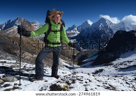 Young woman hiking (trekking) in spectacular high mountains, Andes, Peru - stock photo