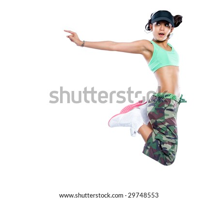 Young woman hip hop dancer jumps up high in the air in a pose - stock photo