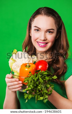 young woman holding a bag full of healthy food