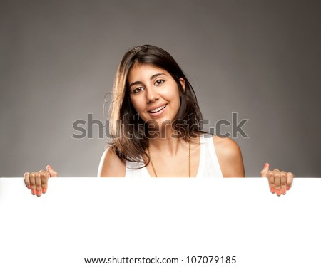 young woman holding a banner - stock photo