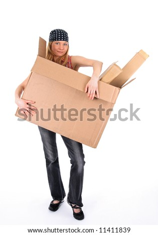 Young woman holding a big cardboard box with copy space. - stock photo